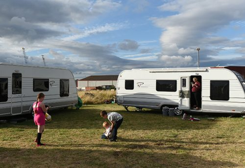 Jean's son David lifts up his cousin Richard who has Richard who has fallen over in the grass, as his sister Viviana walks by and Aunt Bernadette stands in the doorway of her trailers. The patch of land in Middlesborough was unoccupied and the families were aboe to stay for two weeks. It is now five years since the Travellers eviction and Basildon council are redeveloping the land that they had said was 'protected greenbelt'.  Jean and her family have yet to find a permanent legal site where they might be permanently allowed to stay.