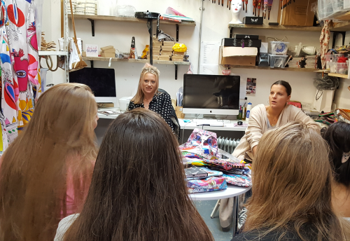 Fashion designer Jess Flint meeting some Bright Futures participants in her studio